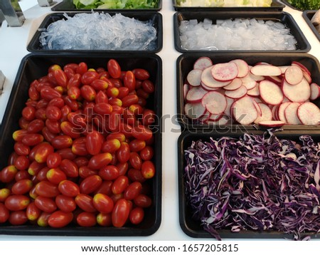 Salads, various fruits, various colors, were placed in trays for customers to choose to eat as healthy food, at a supermarket.