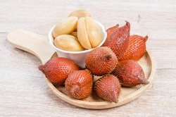Salak Palm , waive or snake fruit on wooden background.