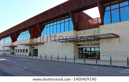 SALAMANCA, CASTILE AND LEON/SPAIN, MAY, 12, 2019: facade and entrances to the airport of Salamanca, called Matacán. Automatic glass doors #1400409140