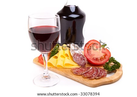 Salami, cheese and tomato on wooden board isolated on white