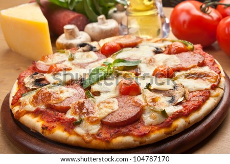 salami, mushroom and vegetable pizza with ingredients