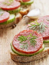 salami sandwich on chopping board, harmful fast food, fatty not healthy food, close-up, close-up