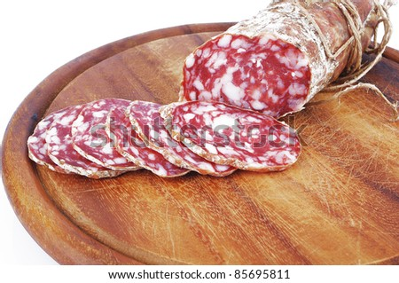 Salami sliced on the white