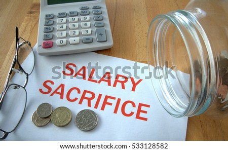 Salary sacrifice with coins on paper and in pot and calculator behind #533128582