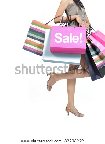 sale concept. woman with a shopping bags isolated on white