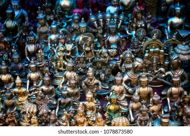 Stock Photo - sale of Indian artifacts and Buddha statues at the market