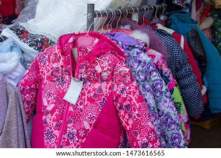 sale of children's jackets,winter jackets for girls are sold on hangers #1473616565