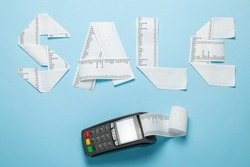 Sale of paper bill and pic terminal for payment on a blue background.