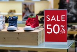 sale 50% off mock up advertise display frame setting over the men shoes shelf in the shopping department store for shopping, business fashion and advertisement concept