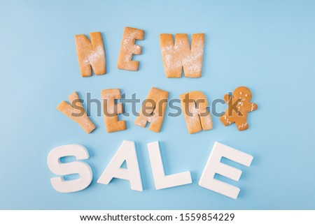 Sale sale sale! High angle view photo of x-mas sale low prices announce billboard made with baked biscuits words letters creative decor isolated blue color background #1559854229