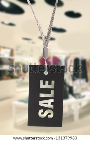 sale sign hanging in clothes shop