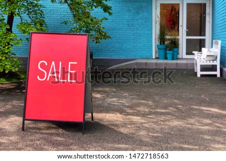 Sale sign near shop door. Mock up advertise display frame setting for shopping, business fashion and advertisement concept