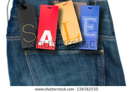 Sale Sign - Paper Tags With Jeans in Background