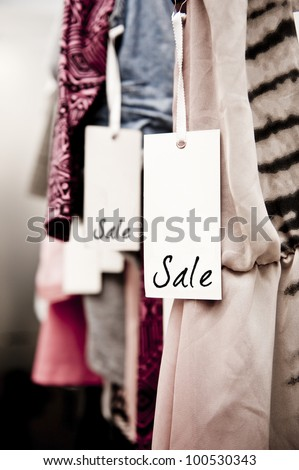 Sale tag on a rack of clothing in a women's boutique