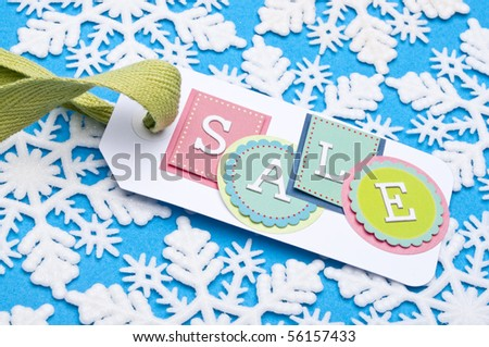 Sale Tag on a Winter Holiday Snowflake Background.