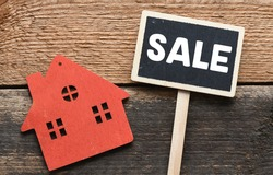 SALE. The word sale written on a chalk board. Sale of real estate - business concept.