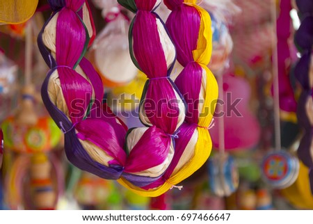 Shutterstock Sale typical sweets in fair of Jocotenango, Guatemala, coconut, peanut, fruits, seeds, bread. Variety of colors and flavors, sample artisan and organic products.