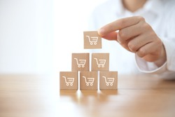 sale volume increase make business grow,  businesswoman flips cube with icon graph and shopping cart symbol.