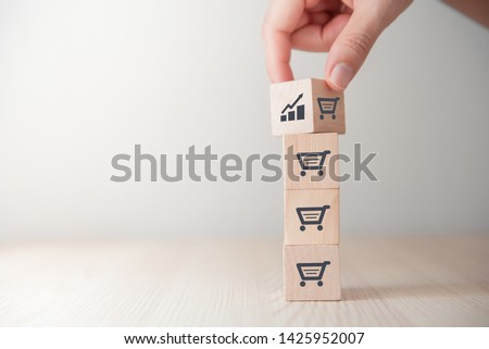 sale volume increase make business grow, Flips cube with icon graph and shopping cart symbol.