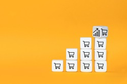 Sale volume increase make business grow. The cube turns over with icon graph and shopping cart symbol.