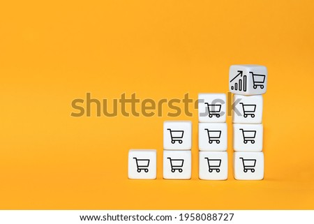 Sale volume increase make business grow. The cube turns over with icon graph and shopping cart symbol. Stock foto ©