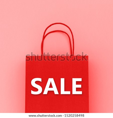 SALE word on red paper shopping bag and wrapping paper background, close up.  Sale concept. Zero waste No Plastic
