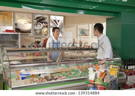 Sales Clerk assisting man at the Deli counter, Beijing