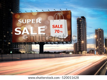 Sales concept, Outdoor billboards, super sale on the highway during the twilight with street light streak. - can be used for trade shows, promotional poster.