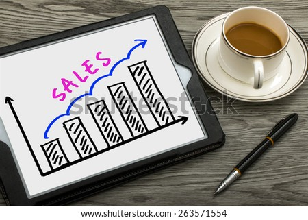 sales graph concept hand drawing on tablet pc #263571554