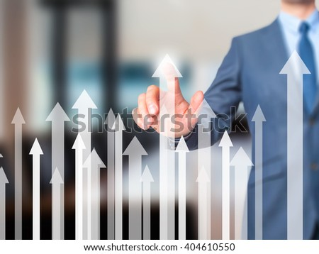 Sales Growth Graph - Businessman hand pressing button on touch screen interface. Business, technology, internet concept. Stock Photo