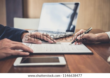 Sales manager filing keys to customer after signing rental lease contract of sale purchase agreement, concerning mortgage loan offer for and house insurance. #1146638477