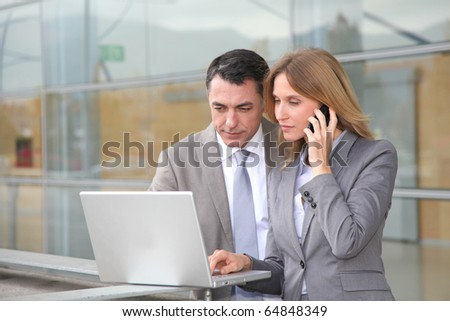 Sales people working outside modern building