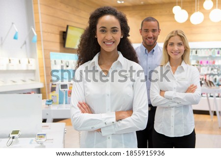 Sales team in a phone store standing with crossed arms Сток-фото ©
