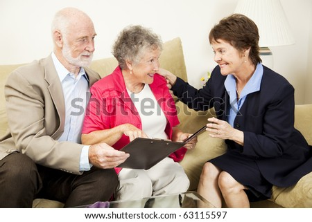 Sales woman making an aggressive pitch to a senior couple.  The husband is skeptical.