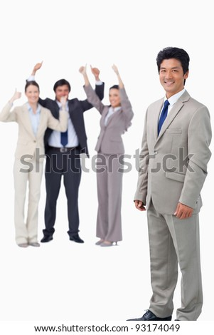 Salesman getting celebrated by his team against a white background