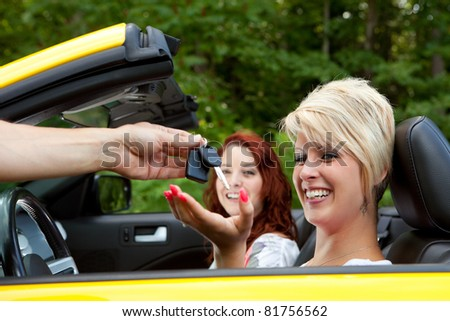 Salesman Giving Happy Customer New Car Keys