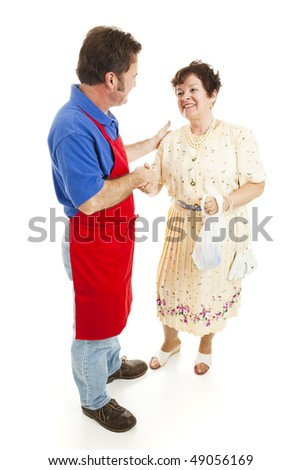 Salesman shakes hands with a happy customer.  Isolated on white.