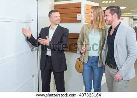 Salesman showing couple building materials