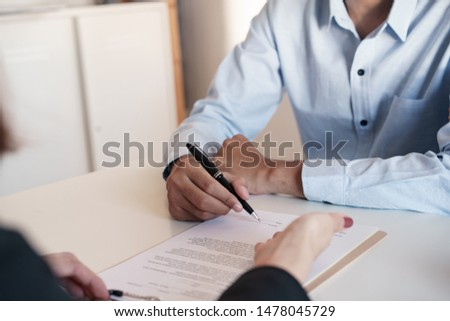 Salesmen are letting the male customers sign the sales contract, Asian women and men are doing business in the office, Business concept and contract signing #1478045729