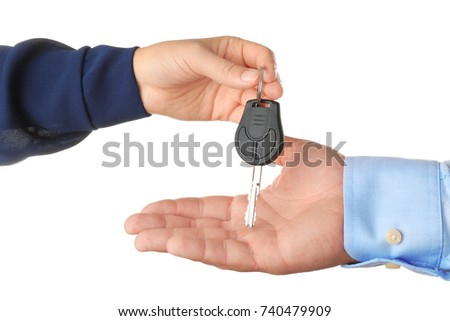 Saleswoman giving car key to customer on white background