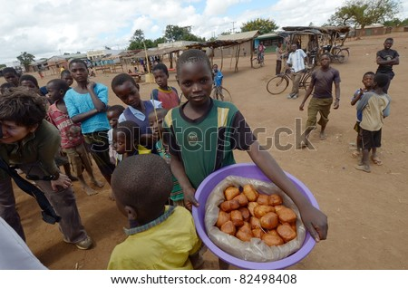 SALIMA,MALAWI – APRIL 6: unidentified child sells sweets made by her mother, in a street of Salima, on April 6, 2011. Many children do not attend school and help their family selling stuff in the street.