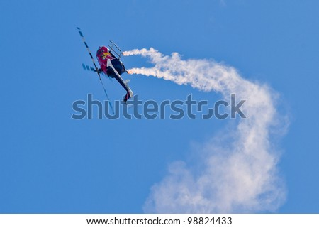 SALINAS, CA - SEPT 25: Pilot Chuck Aaron demonstrates the highest level of pilot skills on Red Bull aerobatic helicopter during the California International Airshow, on September 25, 2011, Salinas, CA