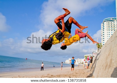 SALINAS, ECUADOR - SEPTEMBER 10: Unidentified Children practicing Parkour a discipline that developed out of military obstacle inthe beach of Salinas, Ecuador on September 10, 2011 in Salinas, Equador