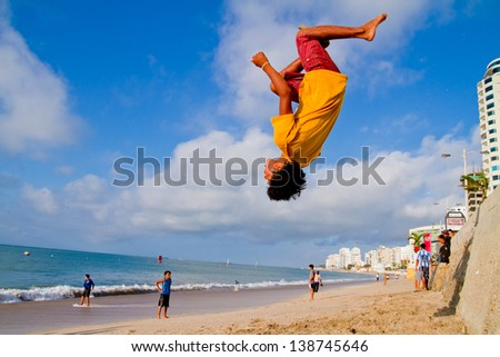 SALINAS, ECUADOR - SEPTEMBER 10: Unidentified kid practicing Parkour that developed out of military obstacle in the beach of Salinas, Ecuador on September 10, 2011 in Salinas, Equador