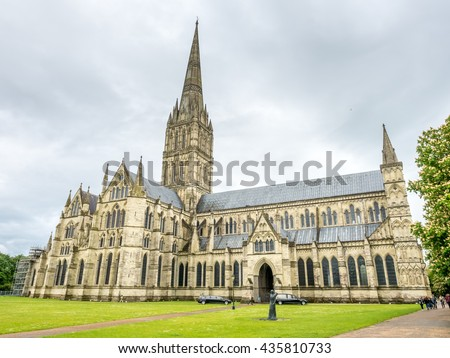 SALISBURY - MAY 18: Salisbury cathedral is an Anglican cathedral in Salisbury, England, under cloudy rain sky. It has the tallest church spire in UK, was taken on May 18. 2016. #435810733