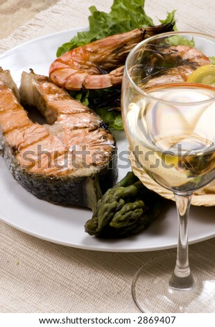 Salmon and shrimp dinner with white wine