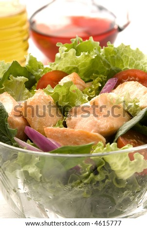salmon and vegetables salad with blurry background