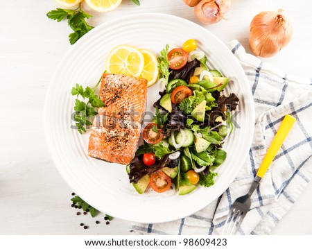 Salmon Baked and Served with Tomatoes, Cucumbers, Avocado, Greens
