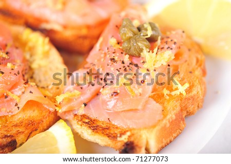 Salmon brushetta with capers and lemon