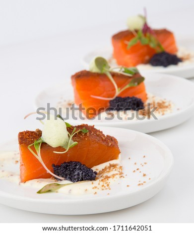 Salmon canapés served with caviar and foam. Photo stock ©